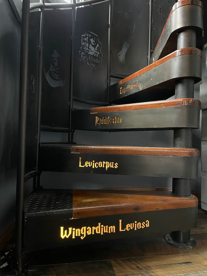 """A decorative staircase is one of the many """"Harry Potter"""" features of Wizards Hollow."""