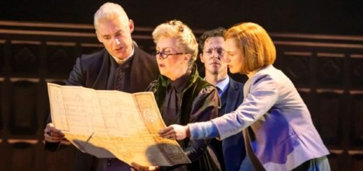 Cursed Child actors of Draco Malfoy, Minerva Mconagall, Harry Potter and Ginny Weasley are in character and on stage looking at the Marauders Map.