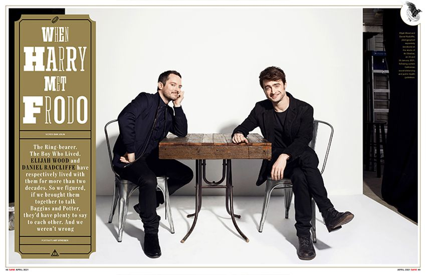 Elijah Wood and Daniel Radcliffe are sitting at the same table in a studio aainst a white backdrop. They are both dressed in elegant black suits and looking at the camera at us while a text box says When Harry met Frodo.