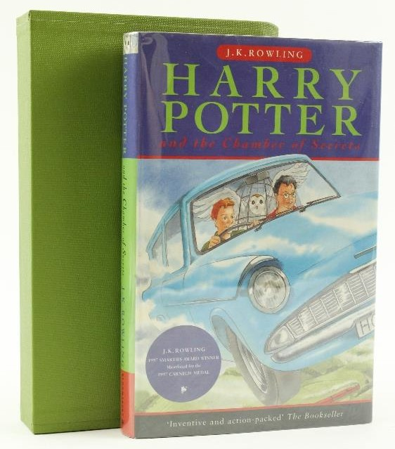 An original Bloomsbury edition of Chamber of Secrets is pictured with a green slipcase.