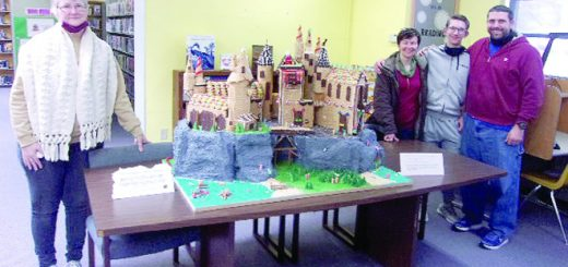 A graham cracker model of Hogwarts castle built by a father and son in Illinois is on display at their local library in New Baden.
