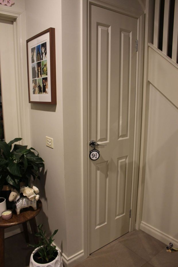 A seemingly unsuspecting white cupboard door under the stairs has a Platform 9 and 3/4 key.