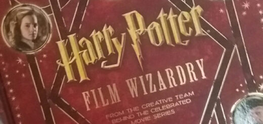 """Red book cover with Harry, Ron and Hermione in circles around the words """"Harry Potter Film Wizardry"""" in gold lettering"""