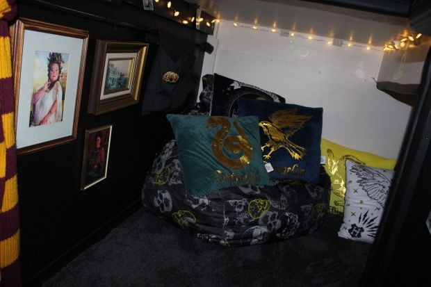 A cupboard under the stairs contains fairy lights, awesome cushions and a bean bag, and framed pictures of the wizarding world including the Fat Lady.