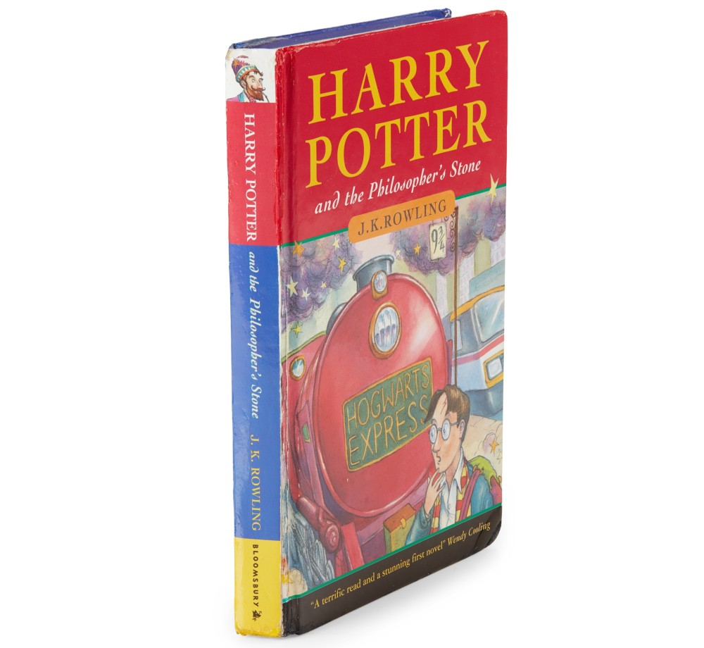 A true hardback copy of Philosopher's Stone is pictured against a white background. The design is directly printed on the hard cover and spine.