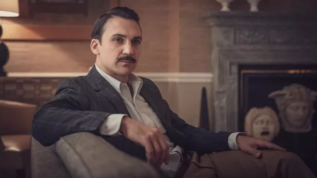 "Henry Lloyd-Hughes sports a stylish mustache as Sherlock Holmes in ""The Irregulars."""