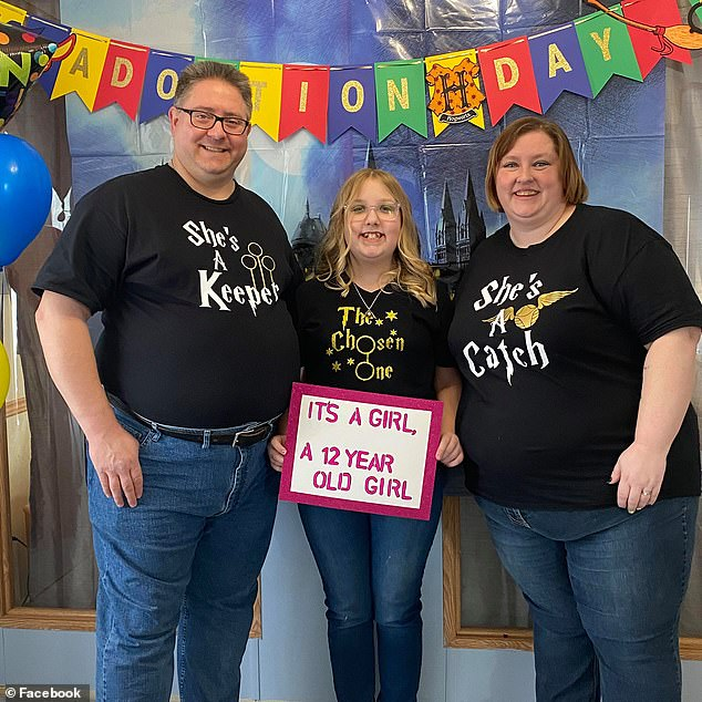 Charlette and Dan Fontaine stood with their newly adopted daughter Bianca