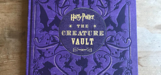 "Purple book cover with the words ""Harry Potter: The Creature Vault"" in gold letters"