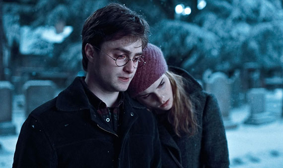 Hermione resting her head on Harry's shoulder in a cemetary