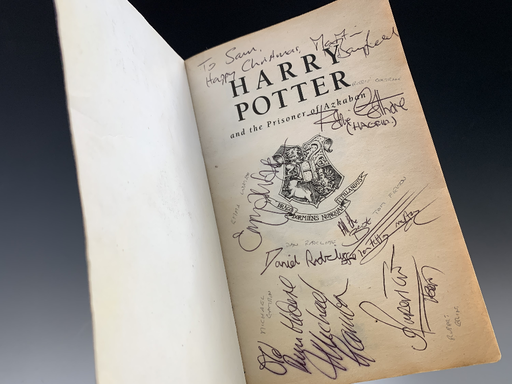 "A copy of ""Harry Potter and the Prisoner of Azkaban"" signed by eight of the film's actors is pictured as displayed by David Lay Auctions."