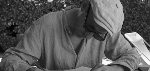 """David Thewlis is pictured writing his novel """"Shooting Martha"""" with a notebook and pen."""