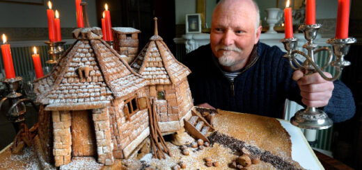 """The Great British Bake-Off""'s Terry Hartill poses with a gingerbread Hagrid's Hut he was commissioned to create."