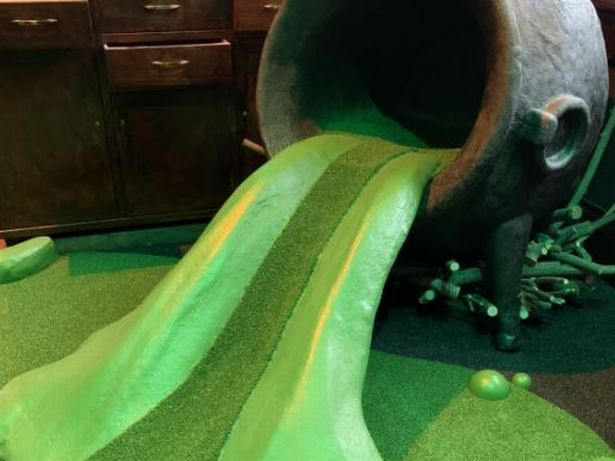 A photo is shown of a cauldron-themed hole at mini golf center the Hole in Wand, opening May 17, 2021.
