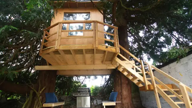 Draiocht Magic House, in Ireland, is a family-friendly rental getaway with a tree house for children to play in.