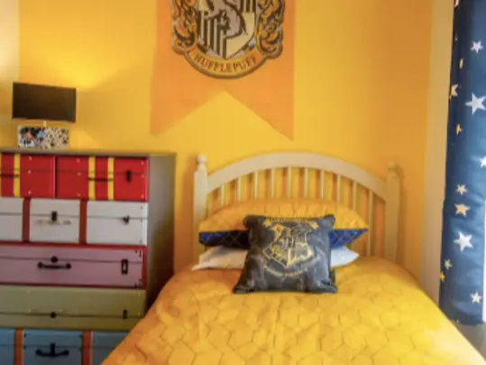 This bedroom in Draiocht Magic House in Ireland has a Hufflepuff color scheme.