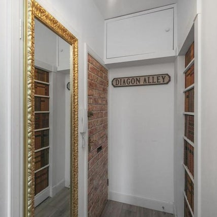 """This magical """"Potter"""" Airbnb in Edinburgh has a hidden cupboard behind a mirror and a hidden bedroom behind a bookcase."""