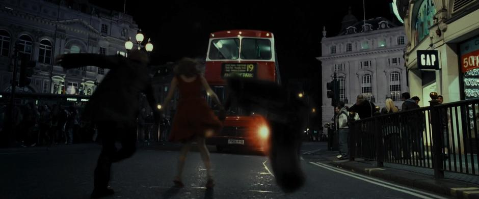 """To flee Bill and Fleur's wedding in """"Deathly Hallows – Part 1,"""" Harry, Ron, and Hermione apparate to Piccadilly Circus"""