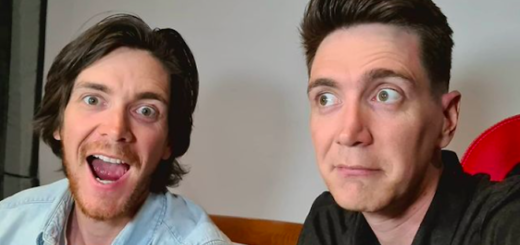 An image of James and Oliver Phelps. James is facing the camera with a wide expression, while Oliver looks slightly away looking concerned.