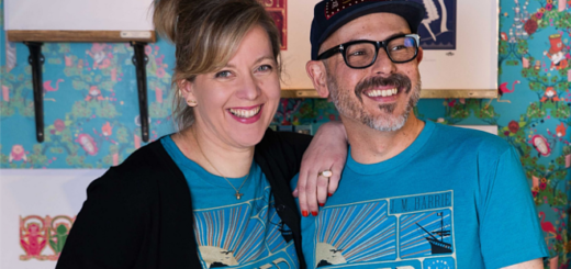 """Miraphora Mina (left) and Eduardo Lima (right) of MinaLima are pictured wearing blue """"Peter Pan"""" T-shirts from the MinaLima Classics apparel collaboration with Out of Print."""