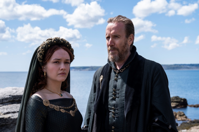 """Olivia Cooke, pictured at the left, and Rhys Ifans (Xenophilius Lovegood), pictured at the right, are shown in character in a still for """"Game of Thrones"""" spin-off """"House of the Dragon."""""""
