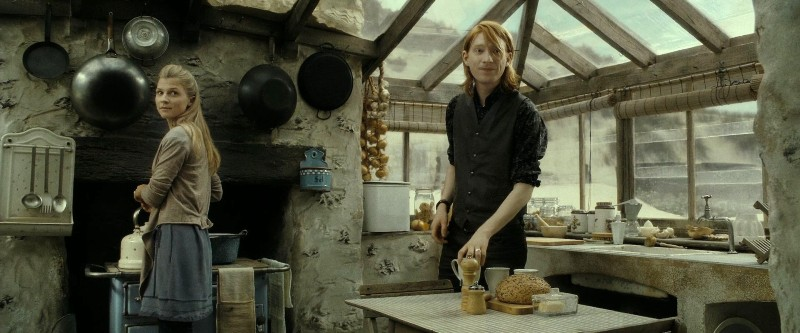 Fleur and Bill are in the kitchen of Shell Cottage on a cloudy day as seen in Deathly Hallows.