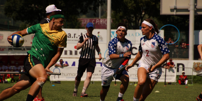 A quidditch player from Australia is photographed in a match against the United States during IQA World Cup 2018.