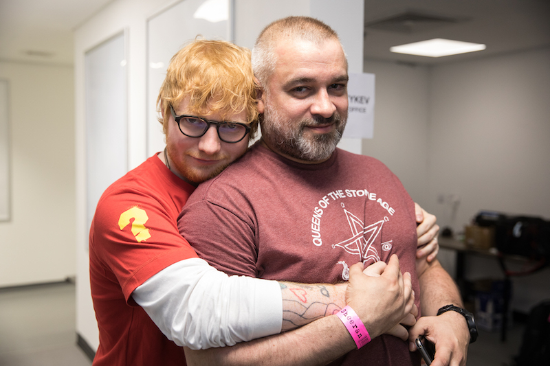 Ed Sheeran is pictured hugging his manager Stuart Camp.