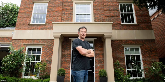Jason Isaacs stood in front of the mansion that is up for raffle for Great Ormond Street Hospital