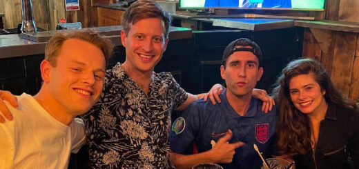 Matthew Lewis and All Creatures cast mates watching football.