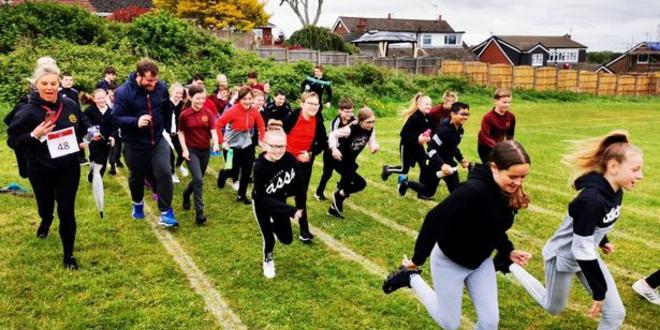 Pupils running a race to raise money