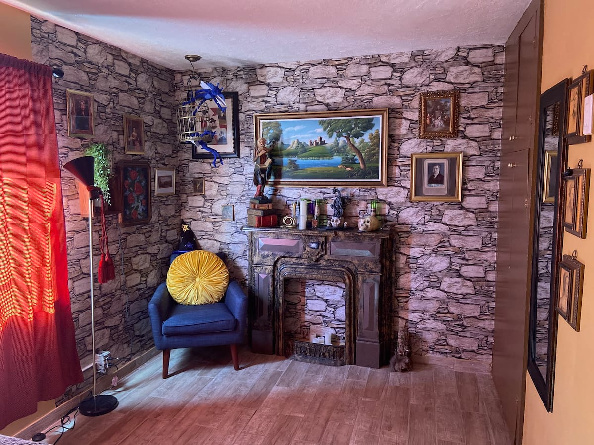 """The fireplace might not be connected to the Floo Network, but it does fit the """"Potter""""-themed decor."""