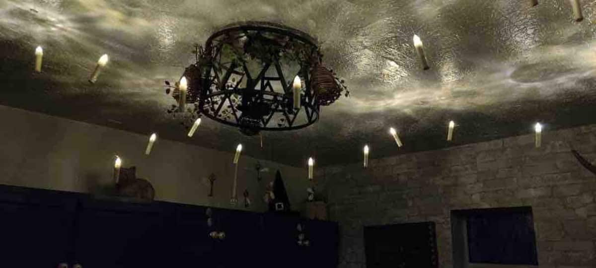 Candles hanging from the ceiling are sure to make any witch or wizard feel at home.