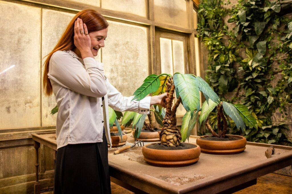 Bonnie Wright visits the re-created Hogwarts greenhouses in the newly-expanded Warner Bros. Studio Tour Hollywood.