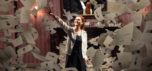 Bonnie Wright reaches for a Hogwarts acceptance letter on a set re-creation at the Warner Bros. Studio Tour Hollywood.