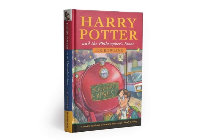 A hardback copy of the first edition of Harry Potter and the Philosopher's Stone is pictured against a white background.
