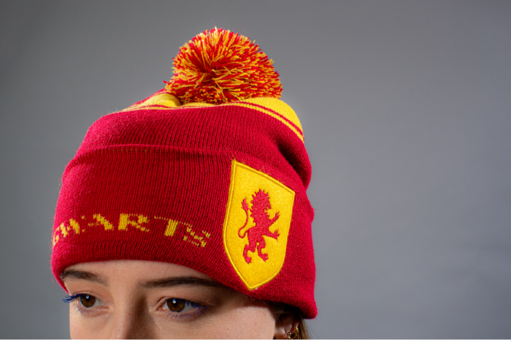 Gryffindor shows its pride with House beanie in bright red and gold colors.