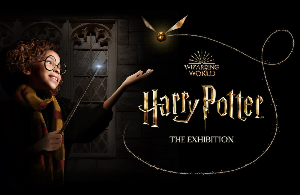 """A promotional image for """"Harry Potter: The Exhibition"""" featuring a young child reaching out for a Golden Snitch."""