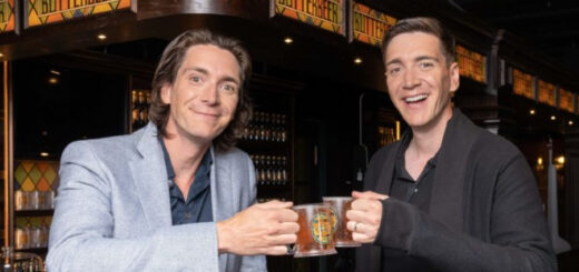 """James and Oliver Phelps trying butterbeer at the """"Harry Potter Photographic Exhibition"""""""