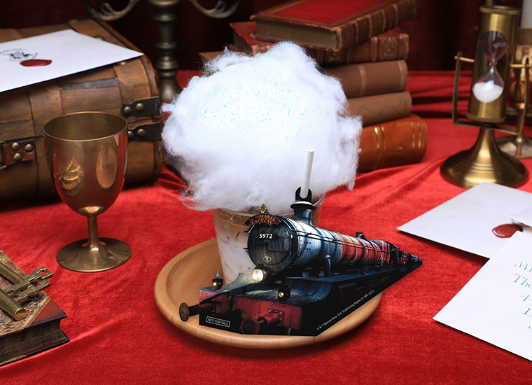 The Hogwarts Express latte has candyfloss smoke pouring out the top.