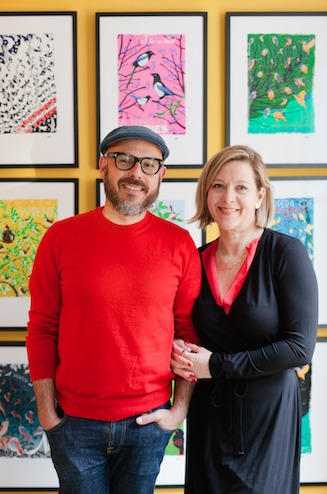 Eduardo Lima and Miraphora Mina pose in front of their Collective Nouns Collection