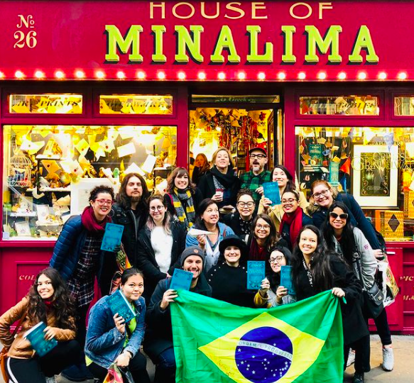 An image of MinaLima meeting a group of Brazilian fans outside the House of MinaLima.