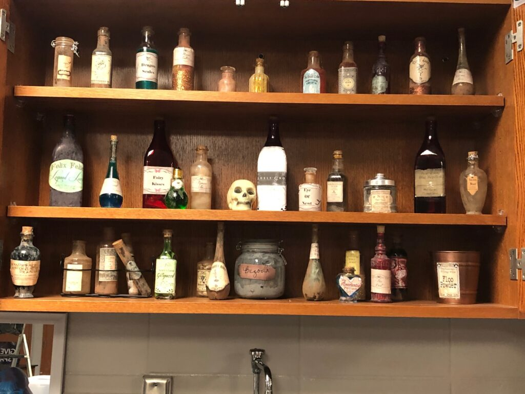 This cabinet holds DIY Potions bottles.