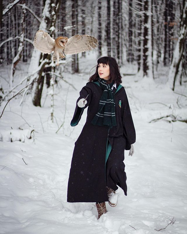 A Harry Potter fan poses for a self-portrait in her Slytherin House robes