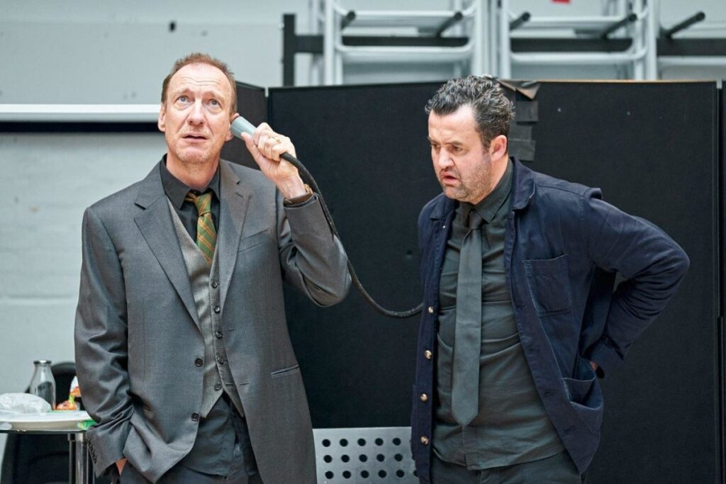David Thewlis with Daniel Mays in rehearsal for The DUmb Waiter, they are listening to a speaking tube.