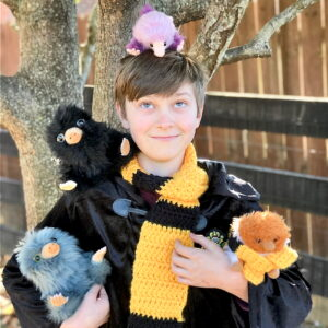 PotterKid surrounded by Nifflers.