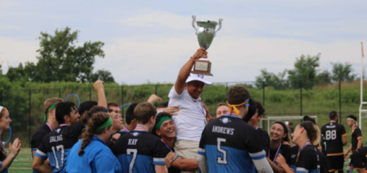 Head coach Juan Martinez raises the Benepe Cup, the league trophy named after quidditch founder Alex Benepe, as he is lifted into the air by his teammates. Photo by Mike Iadevaia