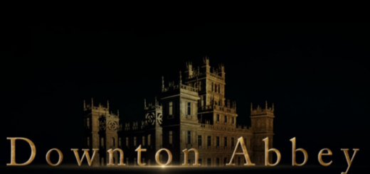 """A promotional image for the second """"Downton Abbey"""" film is shown, featuring the exterior of Downton Abbey outlined in gold plus """"Downton Abbey"""" written below it. The film's complete title is not shown."""