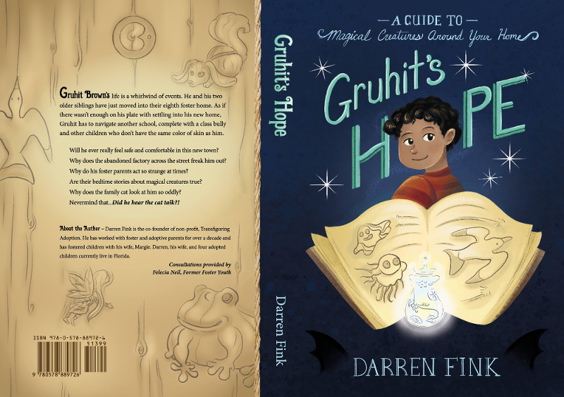 """The artwork for """"Gruhit's Hope"""" by Darren Fink is shown. The cover art, by Alexandra Brodt, features a young boy with dark skin, eyes, and hair against a blue background. In the foreground in front of him is a sketchbook."""