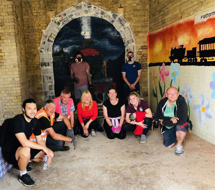 A group shot in front of a Hogwarts Express wall mural in Lincolnshire, UK