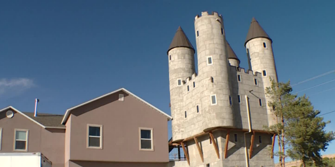 Wade Poulson's castle playhouse is shown as photographed by local news channel KSL. The castle itself towers over Poulson's two-story home.